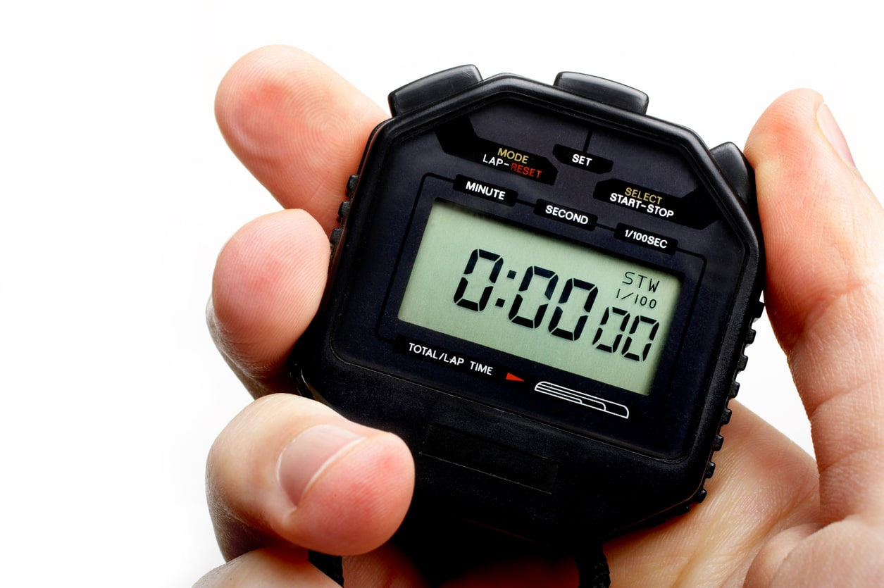 Hand holding a digital stopwatch. Ready to start timing.